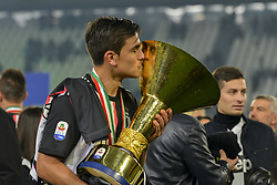 May 19, 2019 - Turin, Turin, Italy - Paulo Dybala of Juventus FC lints the trophy of Scudetto  2018-2019 at Allianz Stadium, Turin  (Credit Image: © Antonio Polia/Pacific Press via ZUMA Wire)