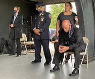 East Meadow, New York, U.S. September 10, 2020. At far right, PATRICK J. RYDER, Commissioner of the Nassau County Police Department, is seated on side of stage as Nassau County commemorates 19th anniversary of September 11 terrorist attacks with Remembrance Ceremony at Eisenhower Park, with names read of 348 county residents killed that day. Due to COVID-19 concerns, participants wore face masks when social distancing was not possible. Event was held at Harry Chapin Lakeside Theater, instead of 9/11 Memorial across the pond, because of rain prediction.