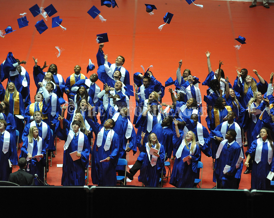 """Students throw their mortar boards in the air as Water Valley holds its graduation ceremony at the C.M. """"Tad"""" Smith Coliseum in Oxford, Miss. on Thursday, May 23, 2013."""