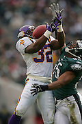 16 Jan 2005:  Onterrio Smith of the Minnesota Vikings with Dhani Jones of the Philadelphia Eagles defending during the Philadelphia Eagles 27-14 victory over the Minnesota Vikings at Lincoln Financial Field in Philadelphia, PA. <br /> <br /> Mandatory Credit:Todd Bauders/ContrastPhotography.com