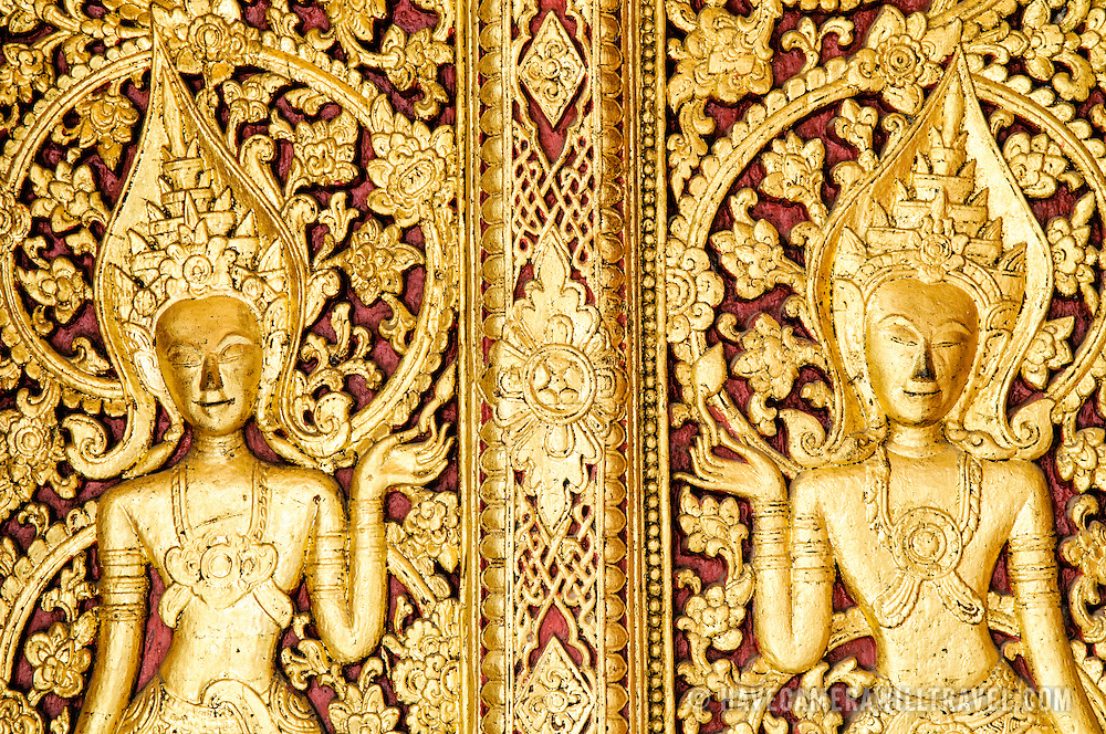 A section of the intricately decorated doors at Wat Mai Suwannaphumaham.  Wat Mai, as it is often known, is a Buddhist temple in Luang Prabang, Laos, located near the Royal Palace Museum. It was built in the 18th century and is one of the most richly decorated Wats in Luang Prabang.