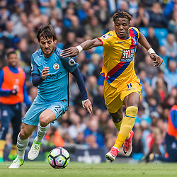 Manchester City midfielder David Silva (21) and Crystal Palace midfielder Wilfried Zaha (11) chase a loose ball<br /> in the English Premier League match between Manchester City and Crystal Palace<br /> (c) John Baguley | SportPix.org.uk
