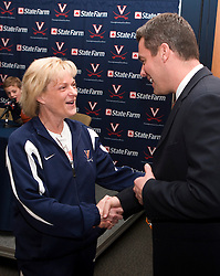 UVA women's head basketball coach Debbie Ryan welcomes Virginia's new men's head coach Tony Bennett.  Tony Bennett was introduced at the new head coach of the University of Virginia's men's basketball program at a press conference held at the John Paul Jones Arena in Charlottesville, VA on April 1, 2009.