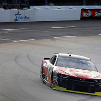 Jamie McMurray (1) races through turn three to practice  for the First Data 500 at Martinsville Speedway in Martinsville, Virginia.