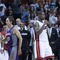 17 November 2010: Miami Heat's shooting guard #3 Dwyane Wade celebrates as Phoenix Suns' point guard #13 Steve Nash walks toward the bench during the Miami Heat 123-96 victory over the Phoenix Suns at the AmericanAirlines Arena, Miami, Florida, USA.