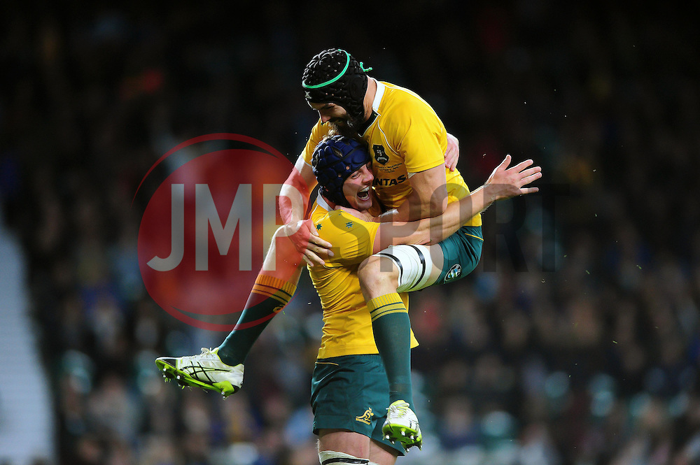 Dean Mumm of Australia celebrates his try with team-mate Scott Fardy - Mandatory byline: Patrick Khachfe/JMP - 07966 386802 - 08/10/2016 - RUGBY UNION - Twickenham Stadium - London, England - Argentina v Australia - The Rugby Championship.