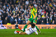 Tyler Roberts of Leeds United (11) tackles Craig Dawson of West Bromwich Albion (25) during the EFL Sky Bet Championship match between Leeds United and West Bromwich Albion at Elland Road, Leeds, England on 1 March 2019.