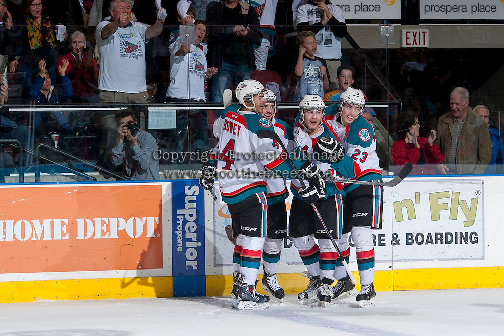 KELOWNA, CANADA - APRIL 25: Madison Bowey #4, Jesse Lees #2, Tyson Baillie #24 and Justin Kirkland #23 of the Kelowna Rockets celebrate a goal against the Portland Winterhawks on April 25, 2014 during Game 5 of the third round of WHL Playoffs at Prospera Place in Kelowna, British Columbia, Canada. The Portland Winterhawks won 7 - 3 and took the Western Conference Championship for the fourth year in a row earning them a place in the WHL final.  (Photo by Marissa Baecker/Getty Images)  *** Local Caption *** Madison Bowey; Jesse Lees; Tyson Baillie; Justin Kirkland;