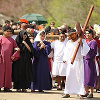Christian Acosta portrays Jesus Christ as members of St. James Catholic Church re-enact the last days of Chirst through the Stations of the Cross Friday afternoon in Tupelo.