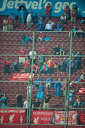 TRABZON, TURKEY - Thursday, August 26, 2010: Liverpool's few travelling supporters brave the rain during the UEFA Europa League Play-Off 2nd Leg match against Trabzonspor at the Huseyin Avni Aker Stadium. (Pic by: David Rawcliffe/Propaganda)