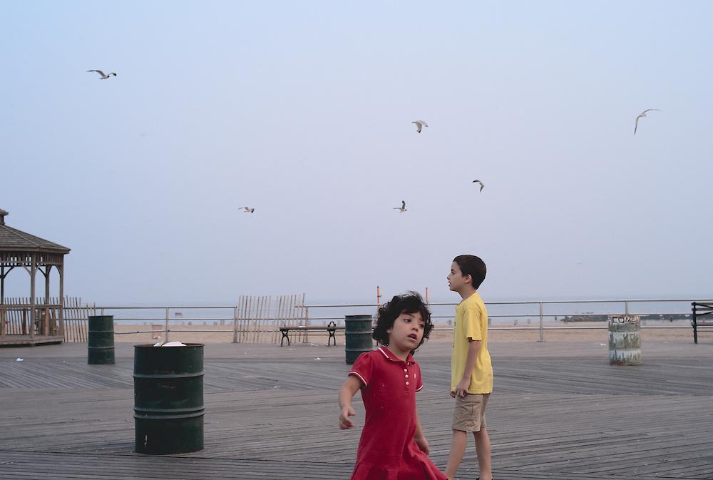 Children on Coney Island boardwalk