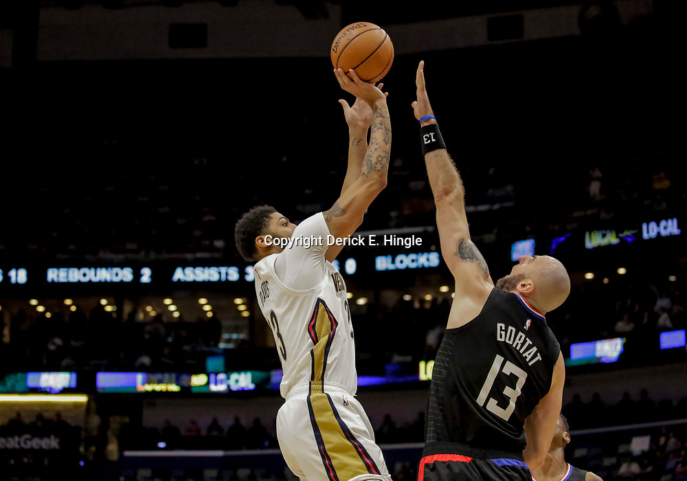 Dec 3, 2018; New Orleans, LA, USA; New Orleans Pelicans forward Anthony Davis (23) shoots over LA Clippers center Marcin Gortat (13) during the second half at the Smoothie King Center. Mandatory Credit: Derick E. Hingle-USA TODAY Sports