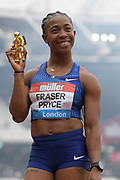 Jul 21, 2019; London, United Kingdom; Shelly-Ann Fraser-Pryce  (JAM) poses with astronaut trophy after winning the women's 100m in 10.78 during the London Anniversary Games at London Stadium at  Queen Elizabeth Olympic Park.