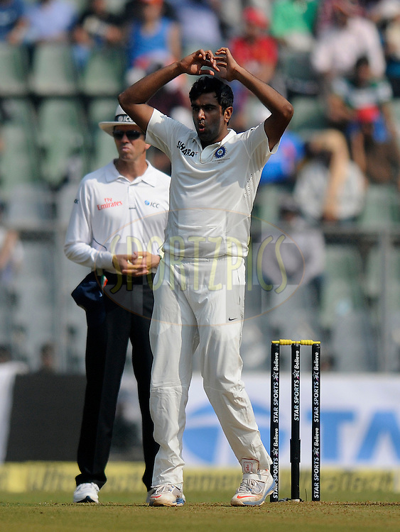 Ravichandran AShwin of India reacts as he bowls during day one of the second Star Sports test match between India and The West Indies held at The Wankhede Stadium in Mumbai, India on the 14th November 2013<br /> <br /> This test match is the 200th test match for Sachin Tendulkar and his last for India.  After a career spanning more than 24yrs Sachin is retiring from cricket and this test match is his last appearance on the field of play.<br /> <br /> Photo by: Pal PIllai - BCCI - SPORTZPICS<br /> <br /> Use of this image is subject to the terms and conditions as outlined by the BCCI. These terms can be found by following this link:<br /> <br /> http://sportzpics.photoshelter.com/gallery/BCCI-Image-Terms/G0000ahUVIIEBQ84/C0000whs75.ajndY