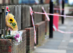&copy; Licensed to London News Pictures. 08/08/2018<br /> Deptford, UK. Flowers left outside a property where 7 year Joel Urhie was killed in a suspicious house fire at Adolphus Street, Deptford.  <br /> Photo credit: Grant Falvey/LNP