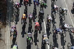 Peloton speed under the bridge at La Flèche Wallonne Femmes - a 120 km road race starting and finishing in Huy on April 19 2017 in Liège, Belgium.