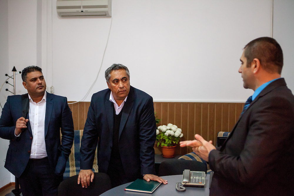 Activist Marian Daragiuin (left) and Roma local councilor Gheorghe Tudor discussing with mayor Manole Aurelian (right) in his office at the town hall in Filipestii de Targ to which Marginenii de Jos belongs. Tudor who has been an activist for social change during the past 25 years, becoming the first elected Roma representative in the local council of Marginenii de Jos in 1992.