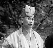 Gempo Yamamoto (1866-1961) Abbot Ryutakuju and Shoin-ji, Japan, acting head of the Myoshin-ji branch of Rinsai Zen Buddhism, 1923.  Head-and-shoulder portrait, in robes, standing looking to right.