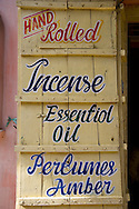 Local products advertised on a sign on a wooden shutter in Pushkar, Rajasthan, India
