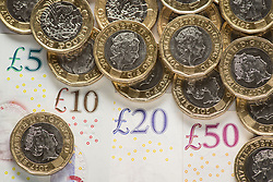 EMBARGOED TO 0001 MONDAY MARCH 25 File photo dated 26/01/18 of bank notes and coins. Contractors in industries including engineering, manufacturing and construction have enjoyed the biggest recent pay rises -up to 75% above the average, a new study suggests.