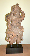 Temple Door Guardian (Dvarapala) 1600-1800.  A wrathful demon, tamed and converted to Hinduism is a suitable guardian for a temple threshold.  This example, fanged and highly animated, was meant to terrify any enemies of the temple god.  He holds a club and has assumed a warrior pose borrowed from theatre and temple dance.