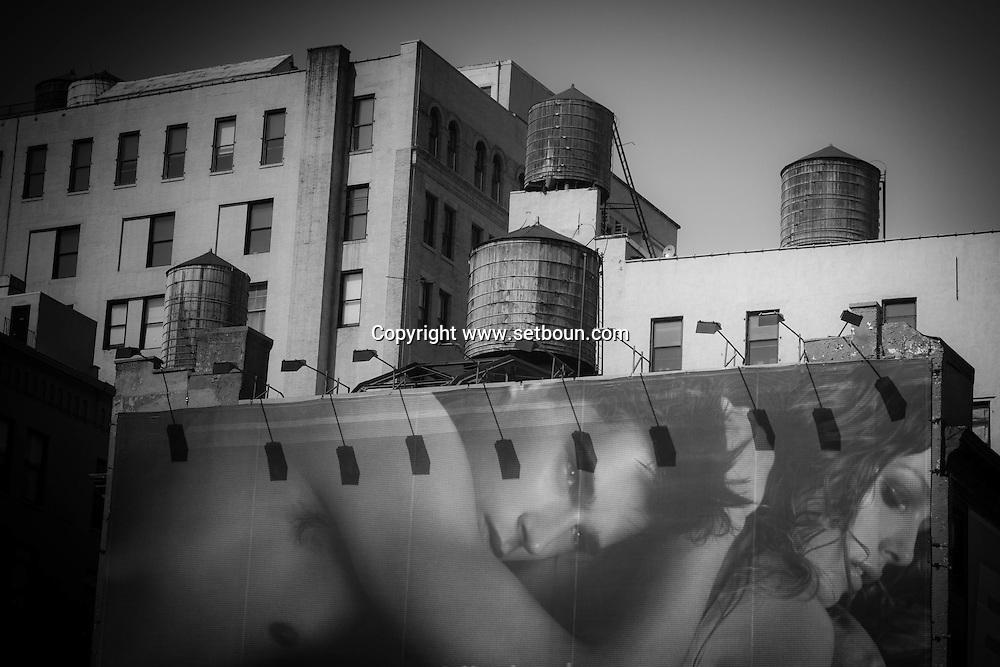 New York Giant ads on Houston street in Soho Manhattan. New York, Manhattan - United states