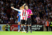 Brentford midfielder Ryan Woods (15)  is shown a yellow card, booked during the EFL Sky Bet Championship match between Brentford and Nottingham Forest at Griffin Park, London, England on 16 August 2016. Photo by Matthew Redman.