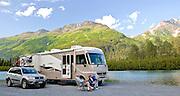 Alaska. Summer visitors camping along scenic Portage Creek, Chugach National Forest. (Model Release)