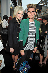 PIXIE GELDOF and HENRY HOLLAND at a party in aid of the charity Best Buddies held at the Hogan store, 10 Sloane Street, London SW10 on 13th May 2009.