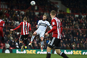 Brentford Midfielder, Lewis Macleod (4) and Middlesbrough Midfielder, Adam Clayton (8) compete for the ball during the EFL Sky Bet Championship match between Brentford and Middlesbrough at Griffin Park, London, England on 17 March 2018. Picture by Adam Rivers.