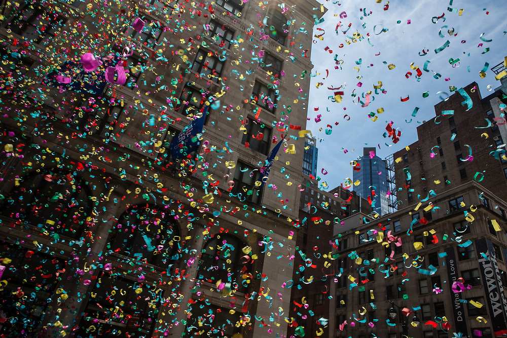 New York, NY - 25 June 2017. New York City Heritage of Pride March filled Fifth Avenue for hours with groups from the LGBT community and it's supporters. The air above Fifth Avenue sis filled with confetti shot from confetti cannons, signaling the start of the march.