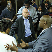 University of Delaware Associate professor Yasser A. Payne Ph.D. (RIGHT) organizes a candid conversation with Delaware Gov. Jack Markell (CENTER) Wilmington Delaware Mayor Dennis Williams (LEFT) and members of the east side community Monday, Jan. 05, 2015 in Wilmington, DE.