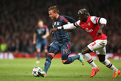 19.02.2014, Emirates Stadion, London, ENG, UEFA CL, FC Arsenal vs FC Bayern Muenchen, Achtelfinale, im Bild Bacary Sagna (Arsenal FC #3) im Zweikampf gegen / tackling against Mario Goetze (FC Bayern Muenchen #19), Aktion, Action // during the UEFA Champions League Round of 16 match between FC Arsenal and FC Bayern Munich at the Emirates Stadion in London, Great Britain on 2014/02/19. EXPA Pictures © 2014, PhotoCredit: EXPA/ Eibner-Pressefoto/ Schueler<br /> <br /> *****ATTENTION - OUT of GER*****