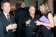 JOSEPH WAN; SIR PHILIP GREEN; TANIA FOSTER-BROWN, Harper's Bazaar Women Of the Year Awards 2011. Claridges. Brook St. London. 8 November 2011. <br /> <br />  , -DO NOT ARCHIVE-© Copyright Photograph by Dafydd Jones. 248 Clapham Rd. London SW9 0PZ. Tel 0207 820 0771. www.dafjones.com.