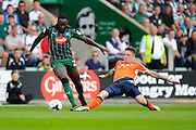 Plymouth Argyle's David Ijaha (22) rides the tackle from Luton Town defender Glen Rea (16) during the EFL Sky Bet League 2 match between Plymouth Argyle and Luton Town at Home Park, Plymouth, England on 6 August 2016. Photo by Graham Hunt.