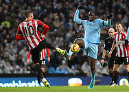 Yaya Toure of Manchester City and Connor Wickham of Sunderland in action during the Barclays Premier League match at the Etihad Stadium, Manchester.<br /> Picture by Michael Sedgwick/Focus Images Ltd +44 7900 363072<br /> 01/01/2015