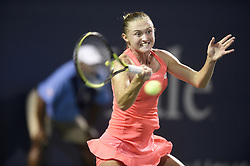 August 21, 2018 - New Haven, CT, USA - Aliaksandra Sasnovich of Belarus returns a shot against Caroline Garcia of France during their second-round match at the Connecticut Open Tennis Tournament in New Haven, Conn., on Tuesday, Aug. 21, 2018. (Credit Image: © John Woike/TNS via ZUMA Wire)