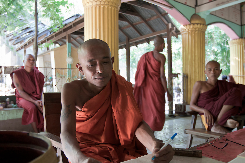Monks collecting donations for new ceramic tile floors at Yankin Paya near Mandalay in central Myanmar.