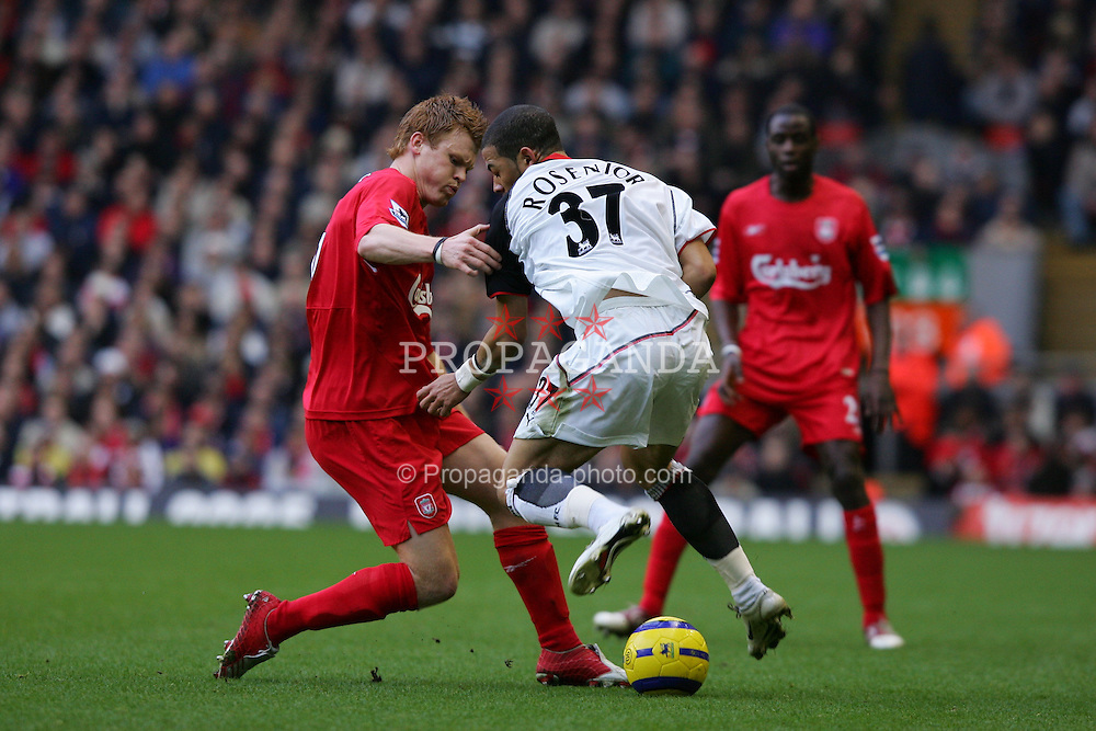 LIVERPOOL, ENGLAND - SATURDAY FEBRUARY 5th 2005: Liverpool's John Arne Riise and Fulham's Liam Rosenior during the Premiership match at Anfield. (Pic by David Rawcliffe/Propaganda)