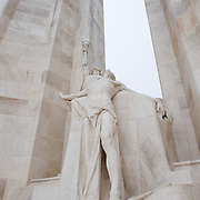 A detail of the center of the twin white pylons  of the ‪Canadian National Vimy Memorial‬ showing the Spirit of Sacrifice. The monument is dedicated to the memory of Canadian Expeditionary Force members killed in World War one. The monument is situated at a 100 hectare preserved battlefield with wartime tunnels, trenches, craters and unexploded munitions. The memorial designed by Walter Seymour Allward opened in 1936.