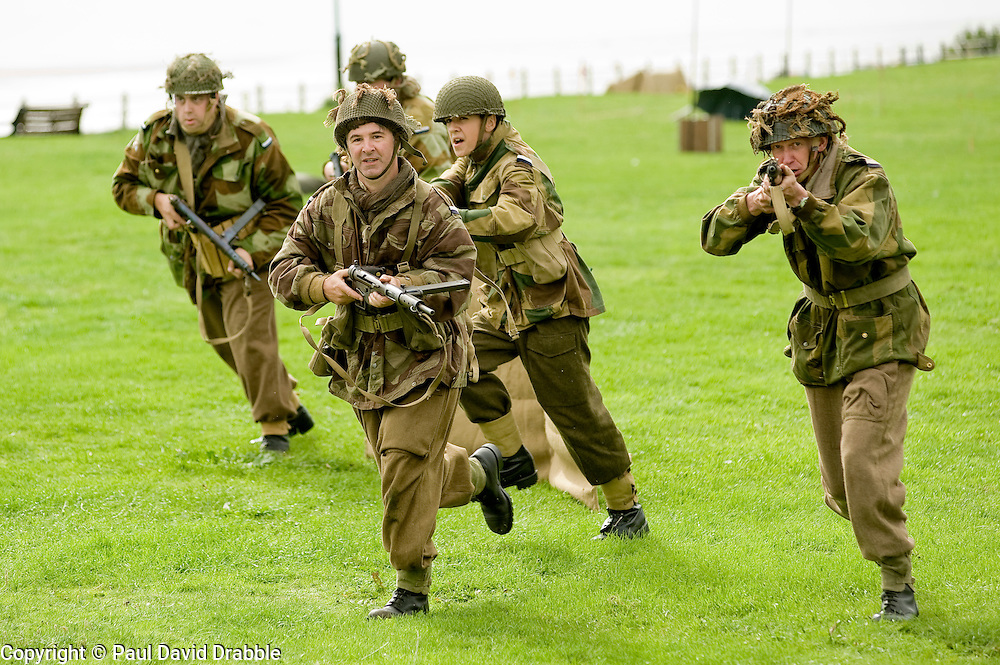 British Paras charge German positions during a Northern World Ward Two Battle reenactment at the Lytham St Annes Battle of Britain Celebration 1940s War Weekend 21 Aug 2010 <br /> Images &copy; Paul David Drabble