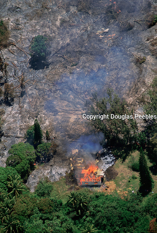 Lava flow through homes, Kalapana, May 1990, Island of Hawaii<br />