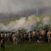 Confederate troops fire on Union positions during the sunrise battle on  Saturday during the weekend-long Battle of Perryville, a national Civil War  Reenactment, in Perryville, Ky., on 10/5/02. The sunrise battle depicts the  opening attack of Daniel Donelson's Confederate Brigade against the center of  the Union First Corps.