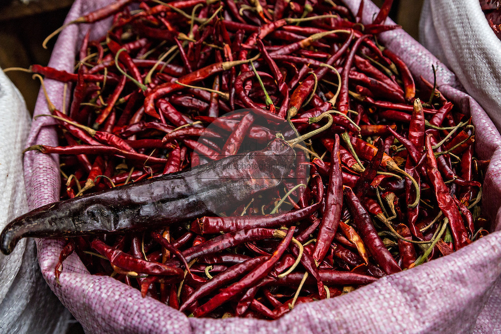 Dried red hot arbol and guajillo chili and pepper at Benito Juarez market in Oaxaca, Mexico.