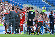 José Antonio Reyes of Sevilla is led off the field with a head injury during the Pre-Season Friendly match between Brighton and Hove Albion and Sevilla at the American Express Community Stadium, Brighton and Hove, England on 2 August 2015. Photo by Phil Duncan.
