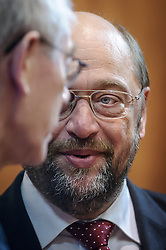 Martin Schulz, president of the European Parliament, right, speaks with Herman Van Rompuy, president of the European Council, as he arrives for the first day of the EU Summit, at the European Council headquarters in Brussels, Belgium on Thursday, Dec. 13, 2012. (Photo © Jock Fistick)