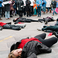 Madison, Wisconsin, USA. 24th March, 2018. Attendees of the Madison, Wisconsin March for Our Lives event perform a die in during the march to the states capitol building.