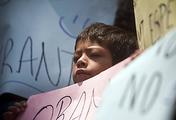 59596925.Mexican children accompanied by their deported parents participate in a protest as part of the Mesoamerican Migrant Movement in front of the headquarters of the U.S. Embassy in Mexico City, capital of Mexico, on May 2, 2013. U.S. President Barack Obama on Thursday kicked off a visit to Mexico and Costa Rica, with focus expected to be on trade, energy, security, as well as immigration issues, on May 2, 2013, May 3, 2013. Photo by: imago / i-Images. UK ONLY