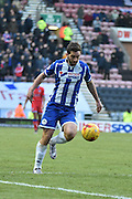 Wigan Athletic Forward, Will Grigg and currently Wigans leading Goal scorer with his eyes firmly on the ball during the Sky Bet League 1 match between Wigan Athletic and Oldham Athletic at the DW Stadium, Wigan, England on 13 February 2016. Photo by Mark Pollitt.