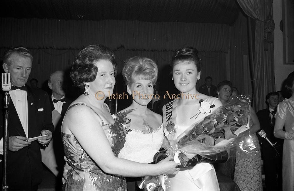 28/04/1965<br /> 04/28/1965<br /> 28 April 1965<br /> Festival of Kerry Dublin Ball at the Gresham Hotel, Dublin. Photo shows winner Miss Irene Courtney (right) receiving her award from Frances McDermott (centre) and Mrs Nanette Barrett, Chairman, Dublin Committee.